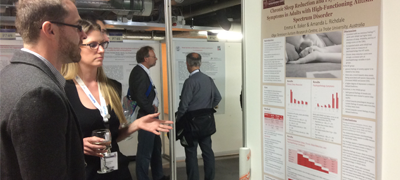 Emma Baker discusses her poster with another researcher at 22nd Congress of the European Sleep Research Society, Tallinn
